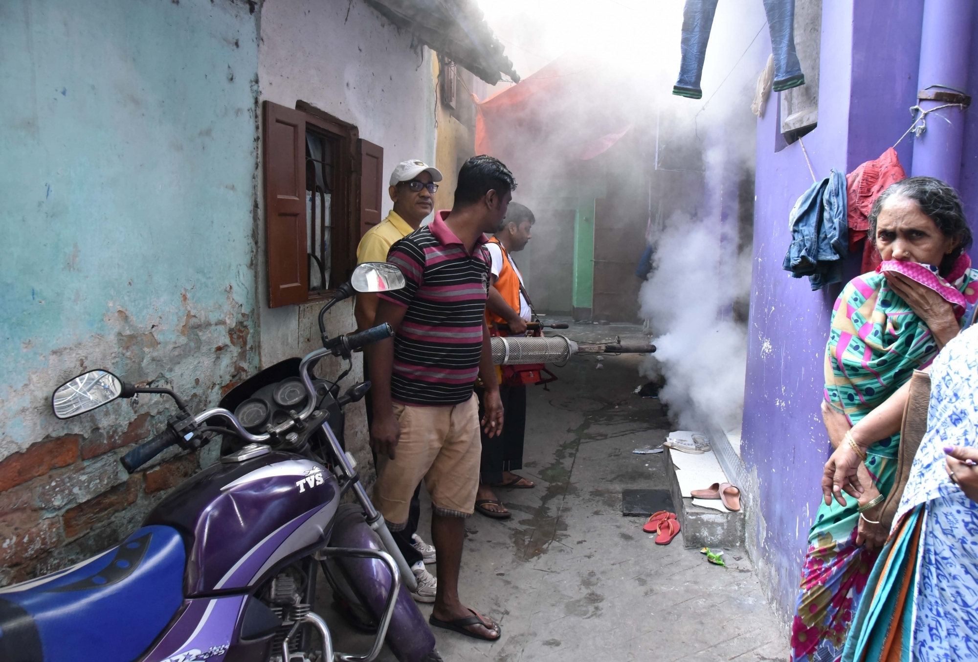 Kolkata Municipal Corporation workers spray chemicals during a fumigation drive on Nov 2, 2017. (Photo: IANS)