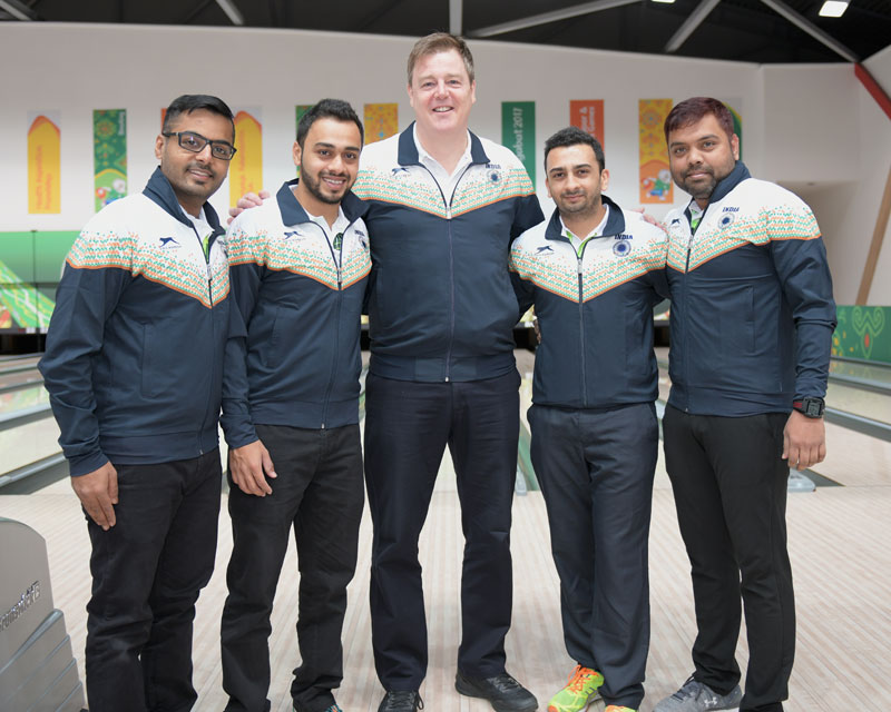 National coach Andrew Frawley (centre), 55, with some of the top Indian bowlers.