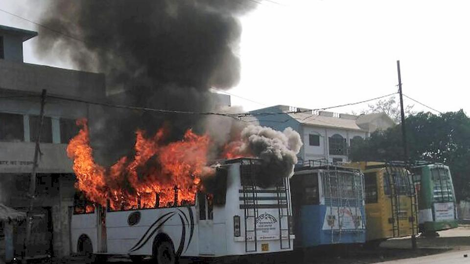 A bus burns after Chandan Gupta's funeral on Saturday. Credit: PTI
