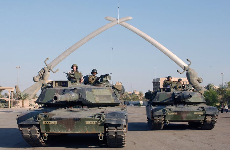 US tanks parked under the Hands of Victory in Ceremony Square, Baghdad, 2003. Photo credit: Technical Sergeant John L Houghton, Jr, United States Air Force