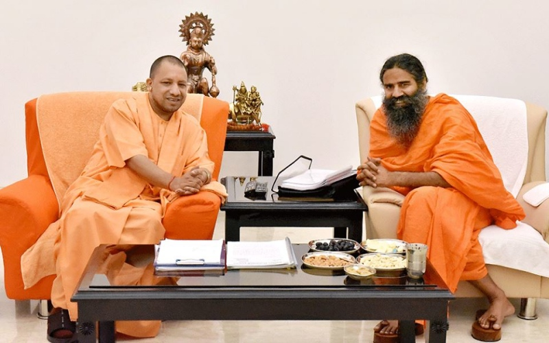 Adityanath (left) and Ramdev. (Photo credit: MYogiAdityanath/Facebook).