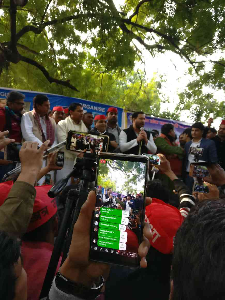 A protestors shoots a Facebook live video of Tejashwi Yadav's speech at the rally. Photo credit: Shoaib Daniyal