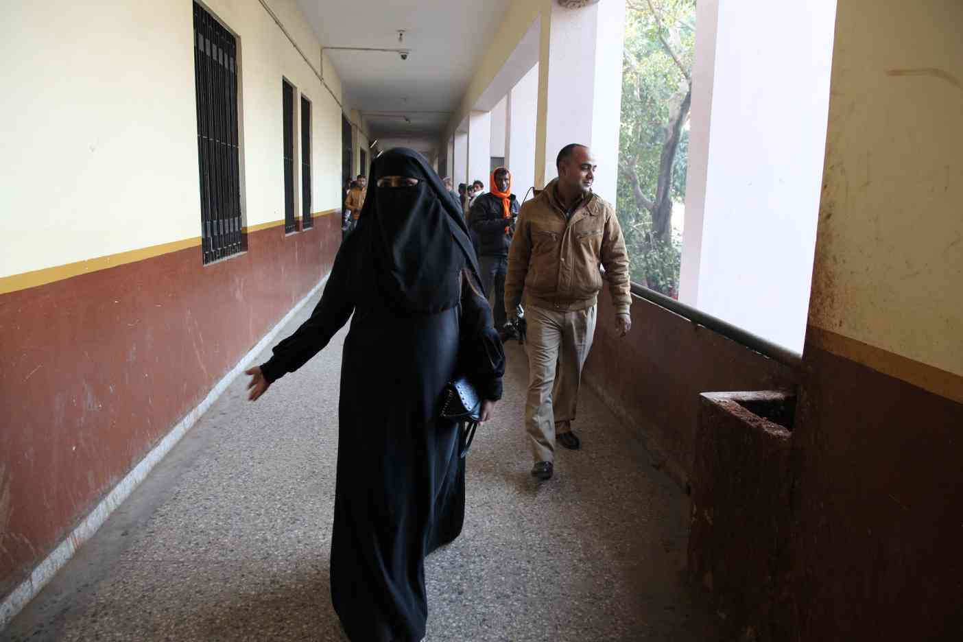 Nida Khan goes to the court with an armed policeman accompanying her.