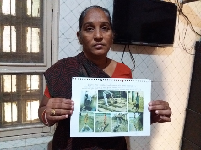 Gauriben Rathod displays images of the kind of manual scavenging that many Valmikis are forced to do. (Photo credit: Aarefa Johari).