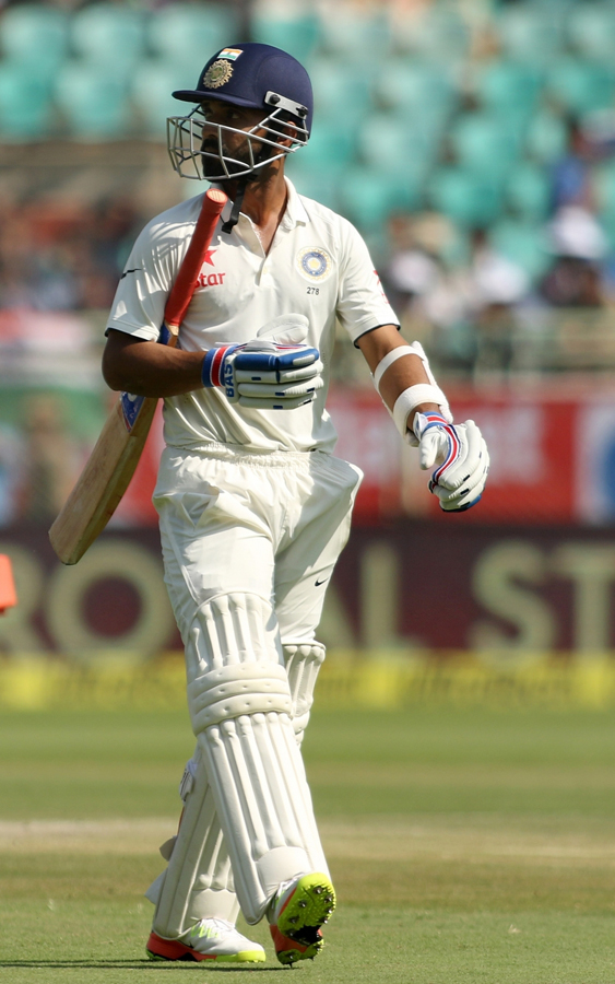 Rahane walks back after being dismissed in the second Test at Visakhapatnam. Image credit: Surjeet Yadav / IANS