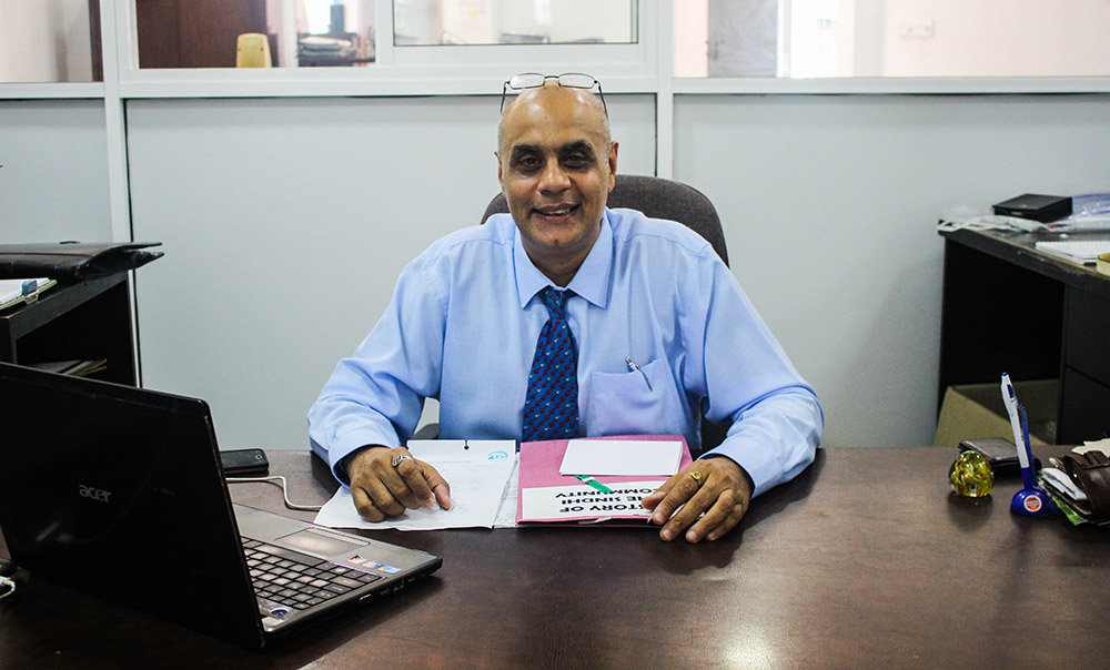 SASL secretary, Sunil Shamdasani, at his desk. Photo credit: Aisha Nazim