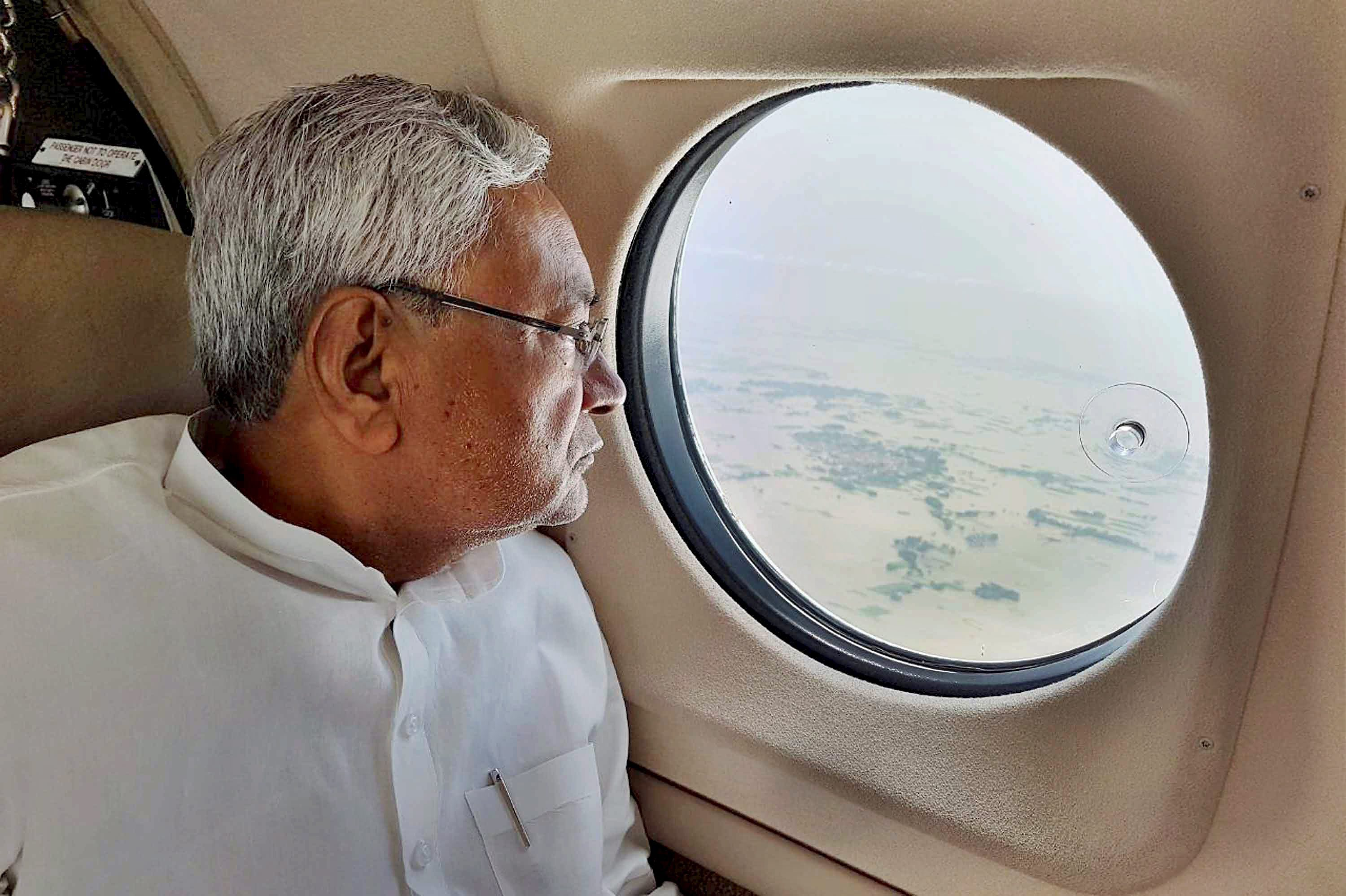 Chief Minister Nitish Kumar takes an aerial survey of flood-affected regions in Bihar. (Credit: PTI)