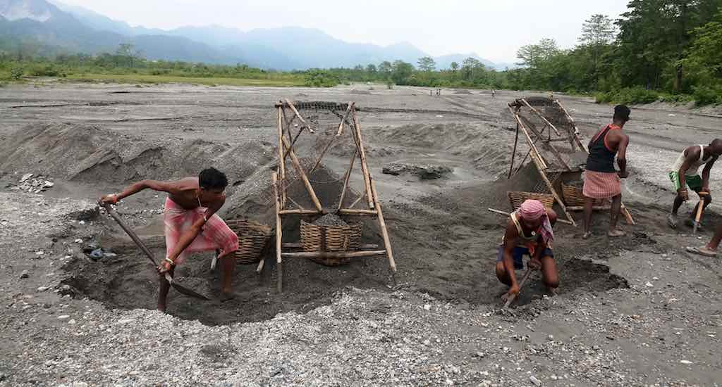 Some workers of the closed Bundapani tea estate have taken to stone crushing to ward off poverty. Photo Credit: Gurvinder Singh