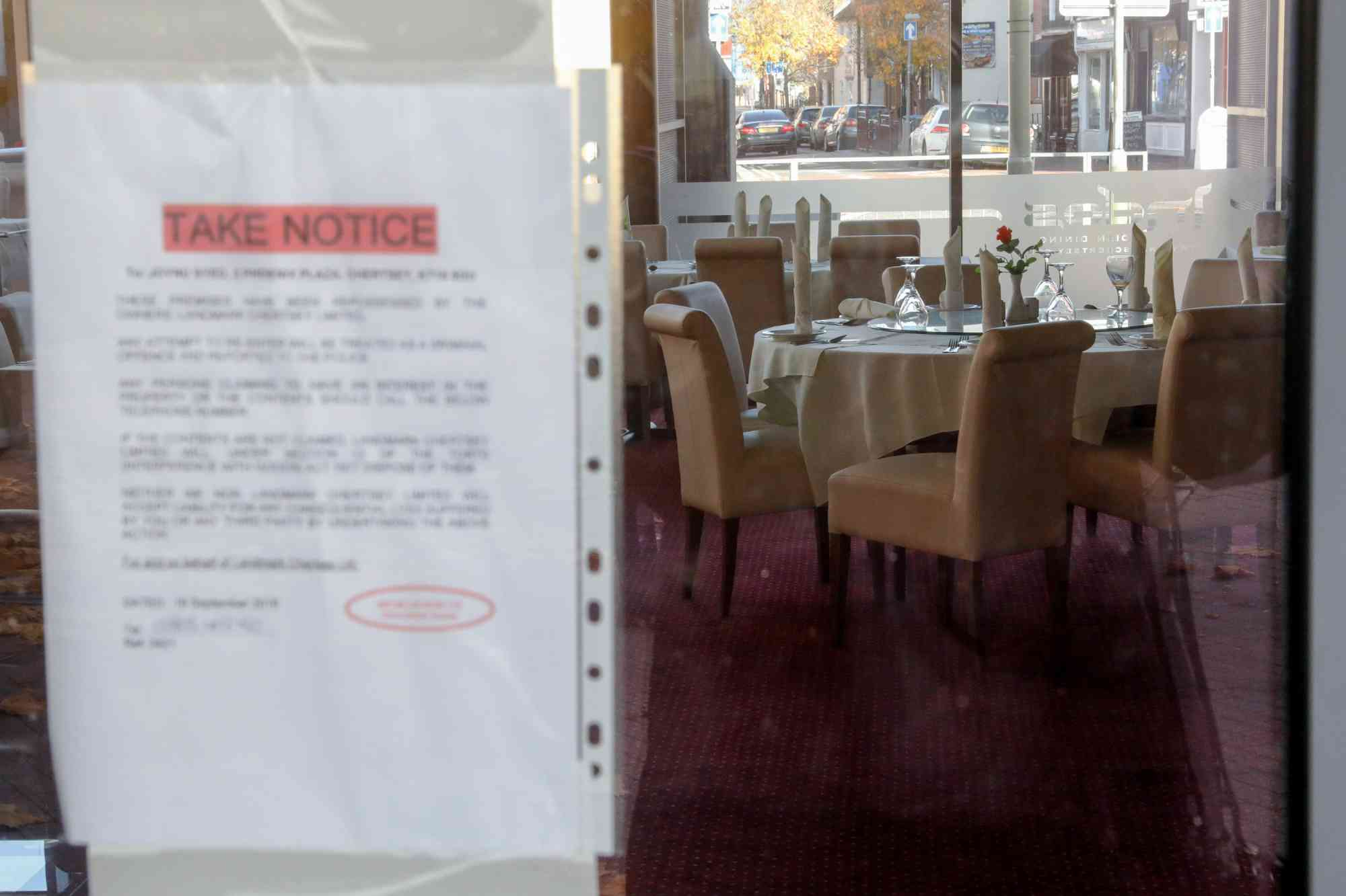 A notice on the window of the shut down Indos Indian restaurant in Chertsey. Credit: Luke MacGregor/Bloomberg