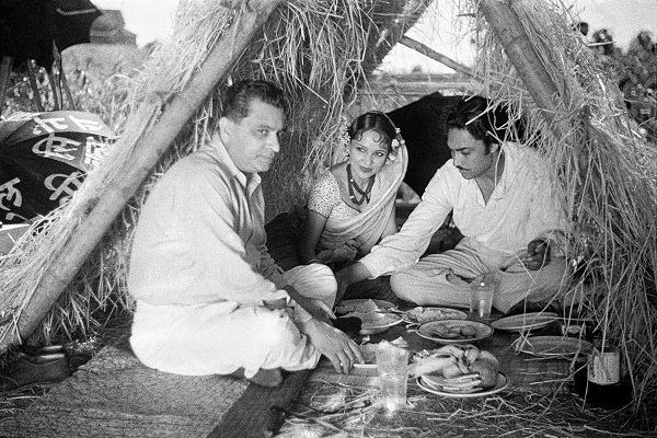 Himansu Rai, Devika Rani and Ashok Kumar on the sets of Franz Osten's Izzat (1937).