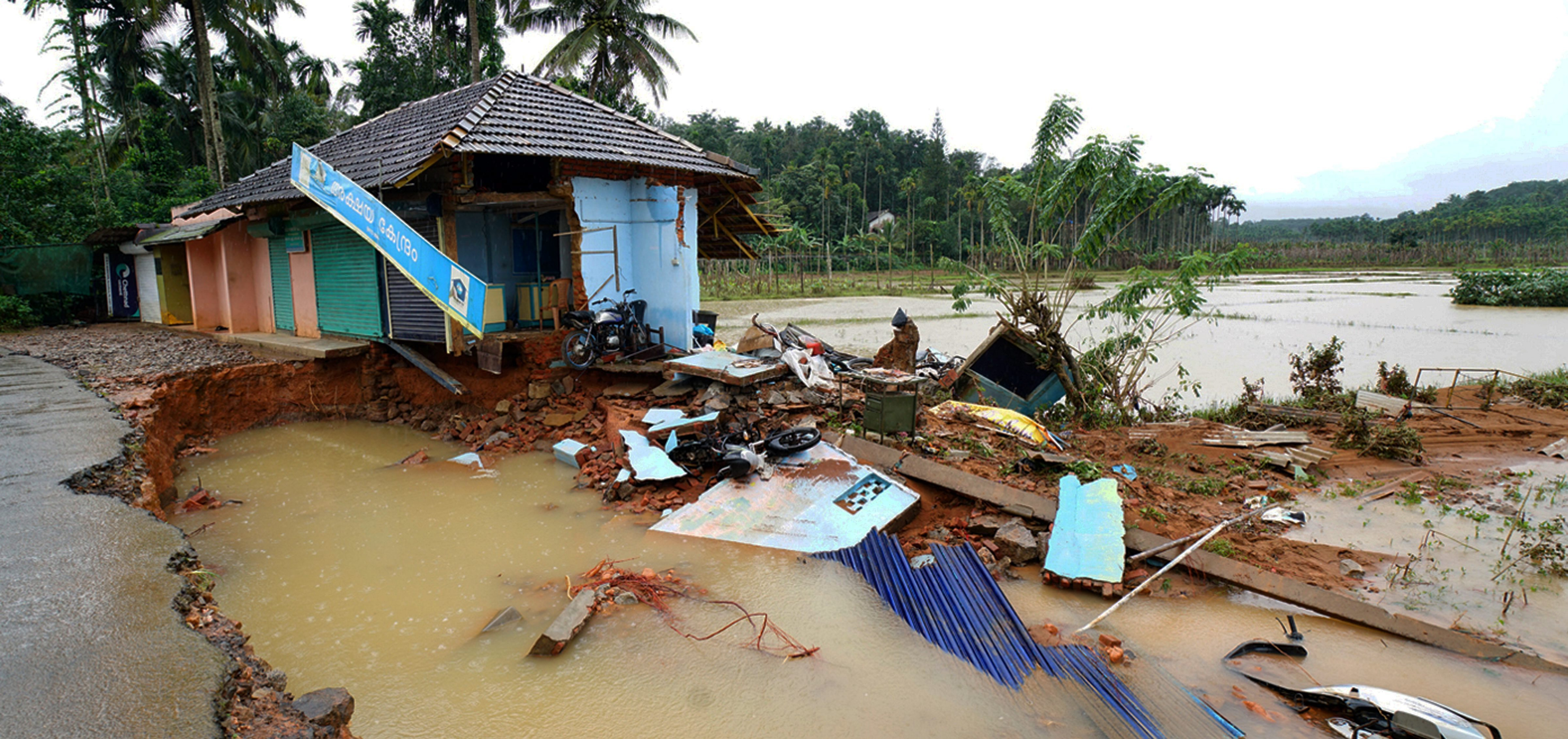 A house damaged by the flooded in Kerala's Wayanad, which is in the Western Ghats. Photo credit: PTI