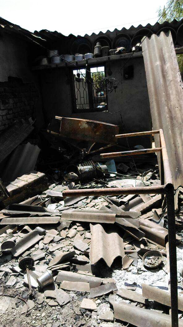 One of the houses that was ransacked and burnt down. Photo credit: Damayantee Dhar