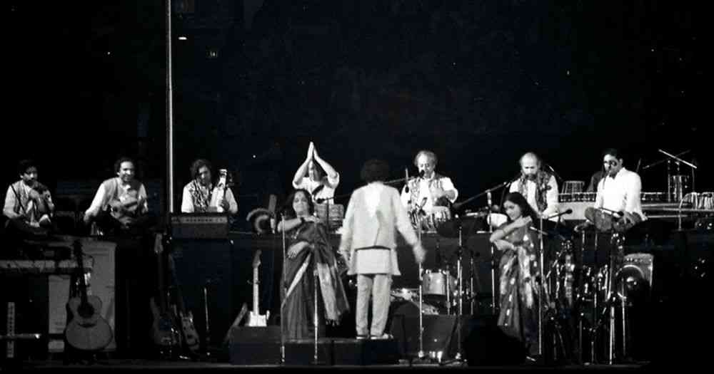 An image from the George Harrison-Ravi Shankar concert in 1974. Harihar Rao, playing the percussion, is on the far right. Photo credit: tony morelli/via Flickr [CC Attribution-ShareAlike 2.0 Generic].