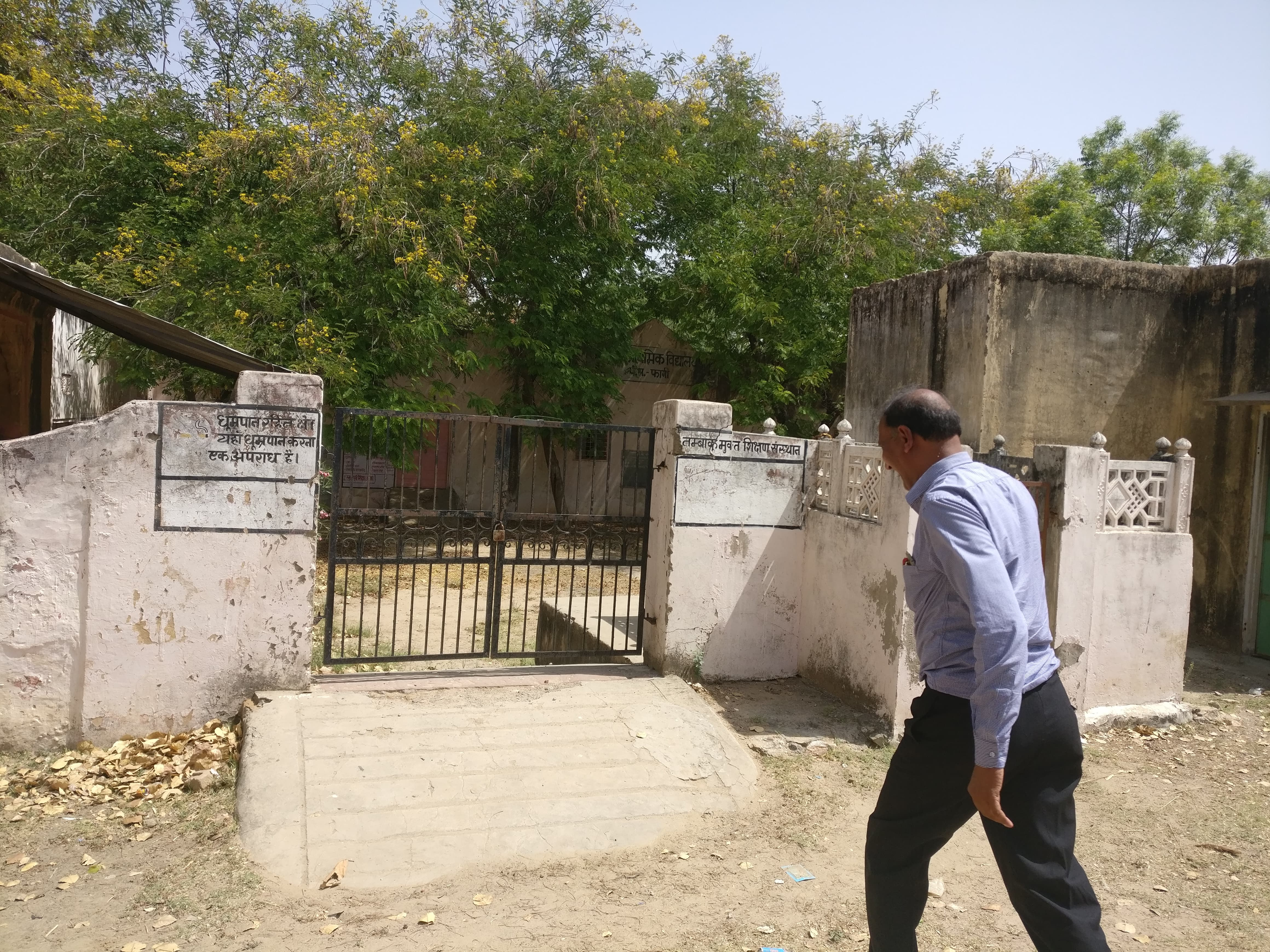 Teacher Ramswarup Jahangir walks to the now abandoned primary school in Pipla.