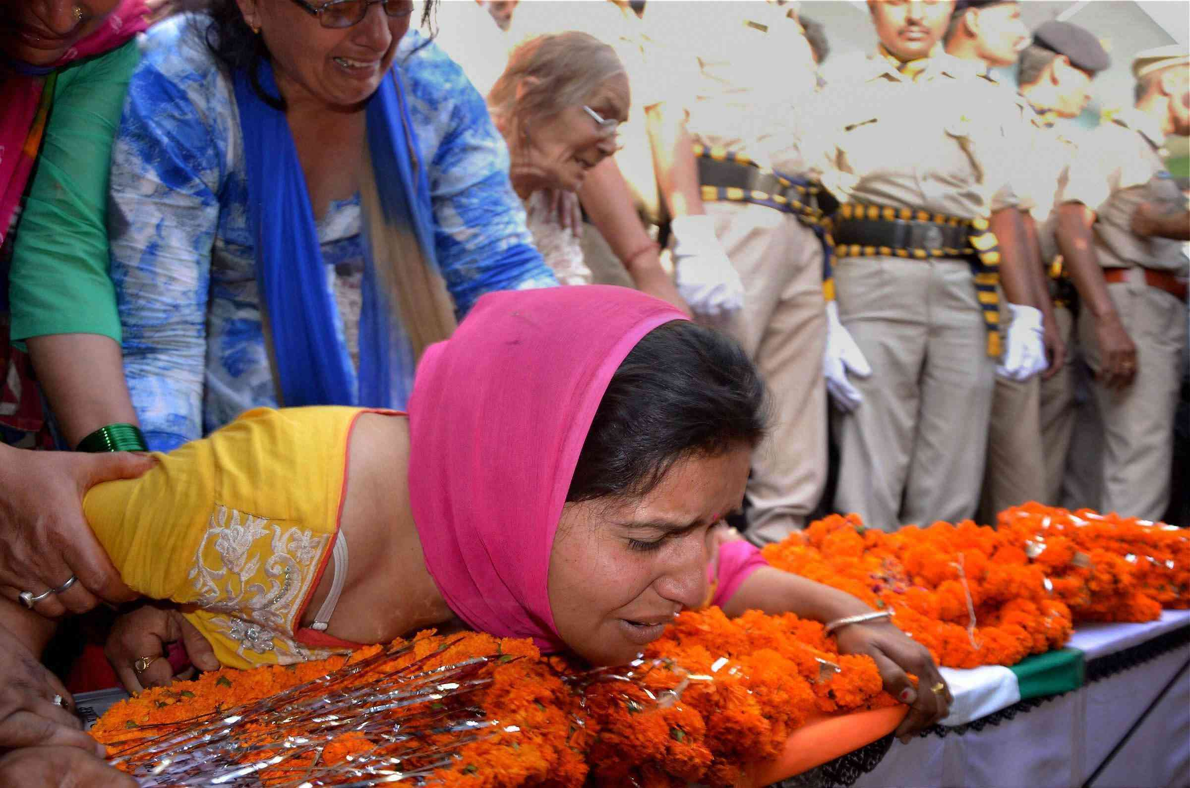 The wife of CRPF soldier Surender Thakur – who was killed in a Naxalite attack in Sukma, Chhattisgarh – cries during his funeral at his village in Himachal Pradesh in April 2017. (Photo credit: PTI).
