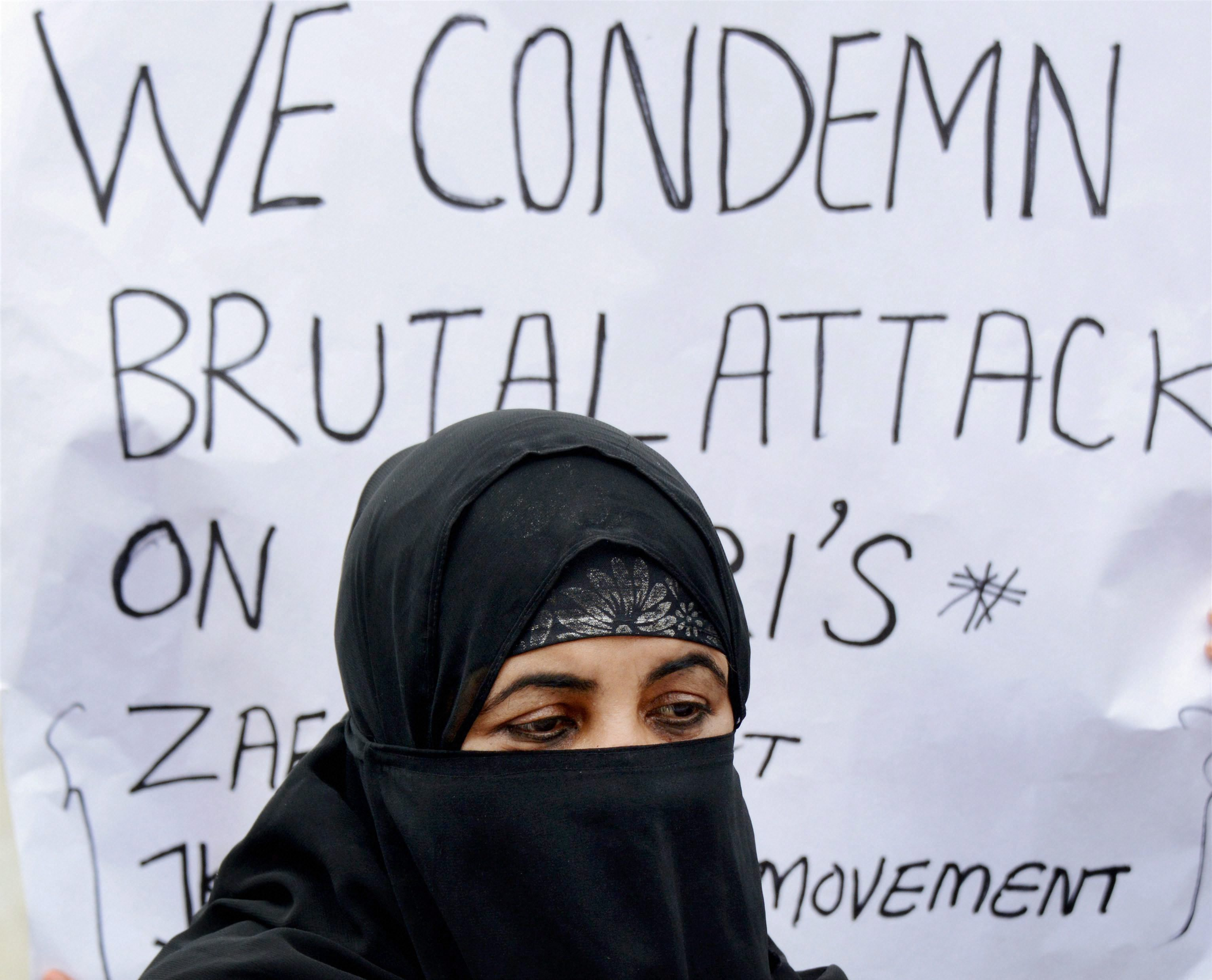 A woman takes part in a protest in Srinagar, Jammu and Kashmir. (Pic: PTI)