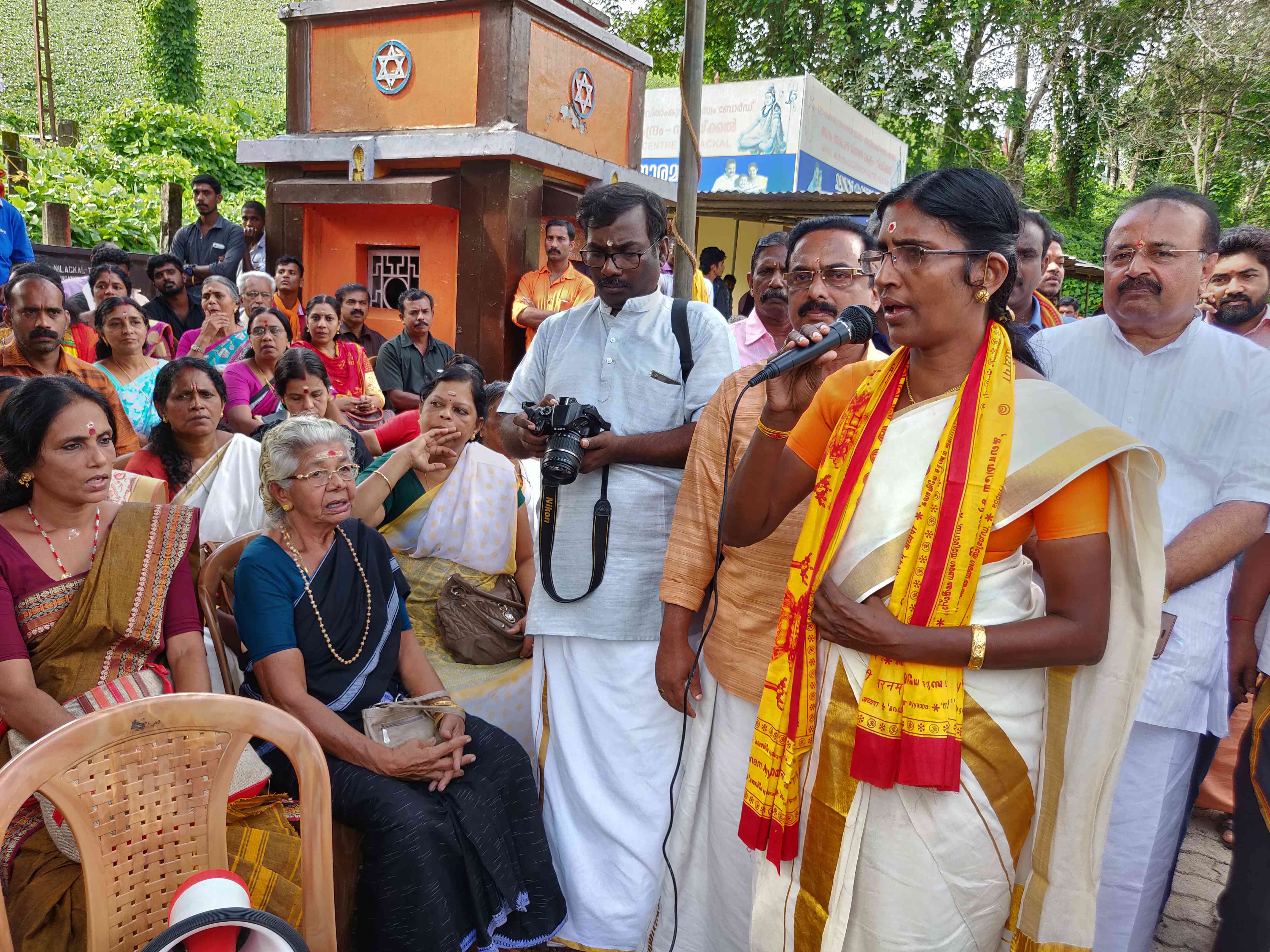 KP Sasikala of the Hindu Aikya Vedi, which is part of the Sangh Parivar, addresses protestors in Nilakkal on Wednesday. (Credit: TA Ameerudheen)