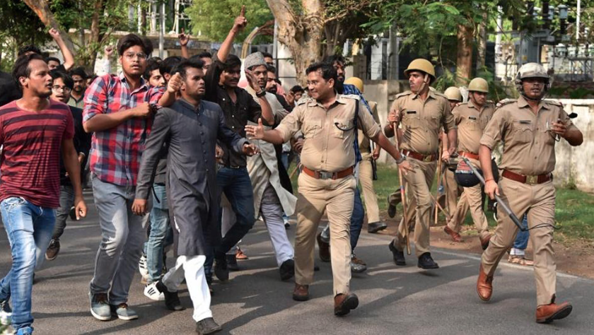 Clashes at the Aligarh Muslim University on Wednesday. (Credit: PTI)