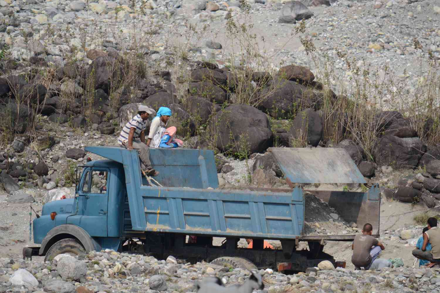 Highway construction workers take some time off. (Photo credit: Anupam Chakravartty).