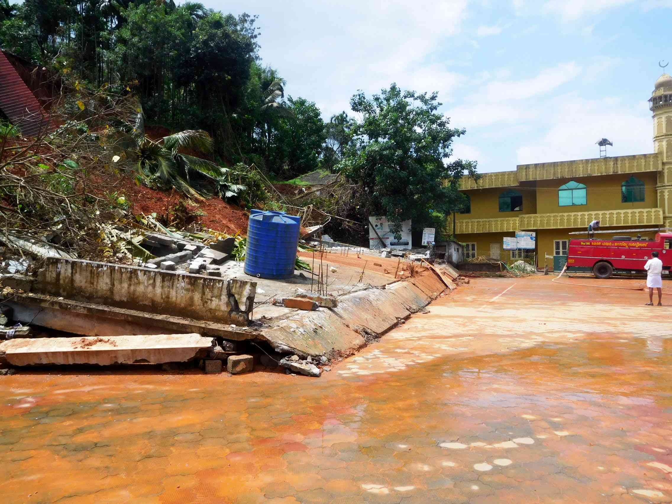 A two-storey shopping complex in Vythiri gram panchayat lies buried under mud. The building stood at the same height as the nearby mosque.