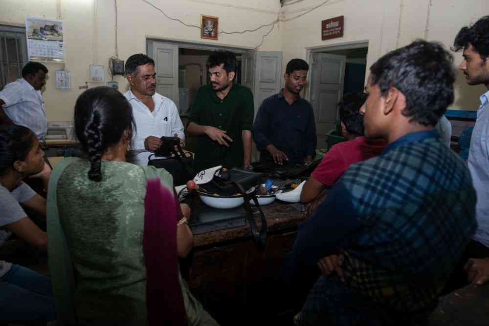 Rajbhar with students at a workshop in a government leather institute.