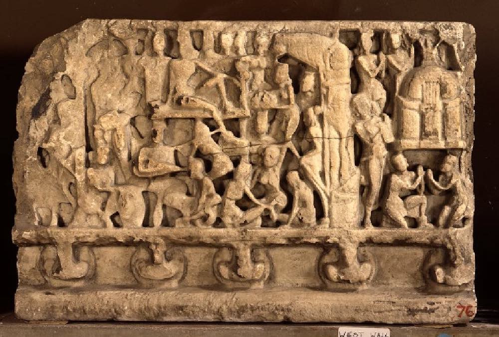 British Museum: Drum-frieze. Fragment of a drum frieze panel in limestone ('Palnad marble') with three remaining registers carved with an unidentified palace scene with men and women adorning a stupa.