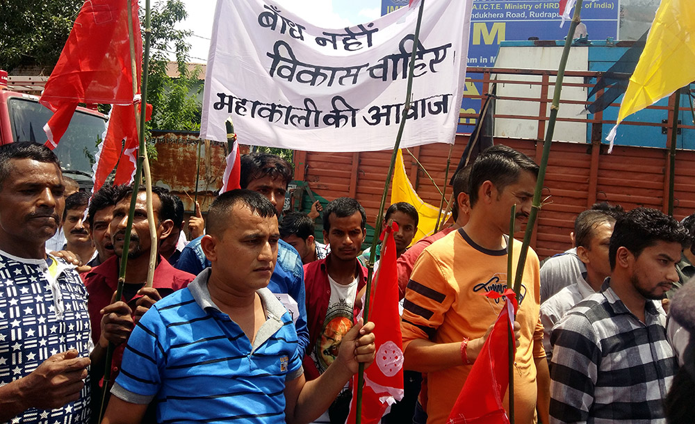 Pithoragarh residents protest outside the venue of a public hearing on the dam project on August 11. Photo credit: Hridayesh Joshi