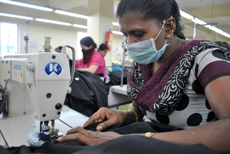 Workers stitch the hem on linen shirts at Lawrence Clothing Pvt Ltd in Bengaluru. (Photo credit: Rohini Mohan)