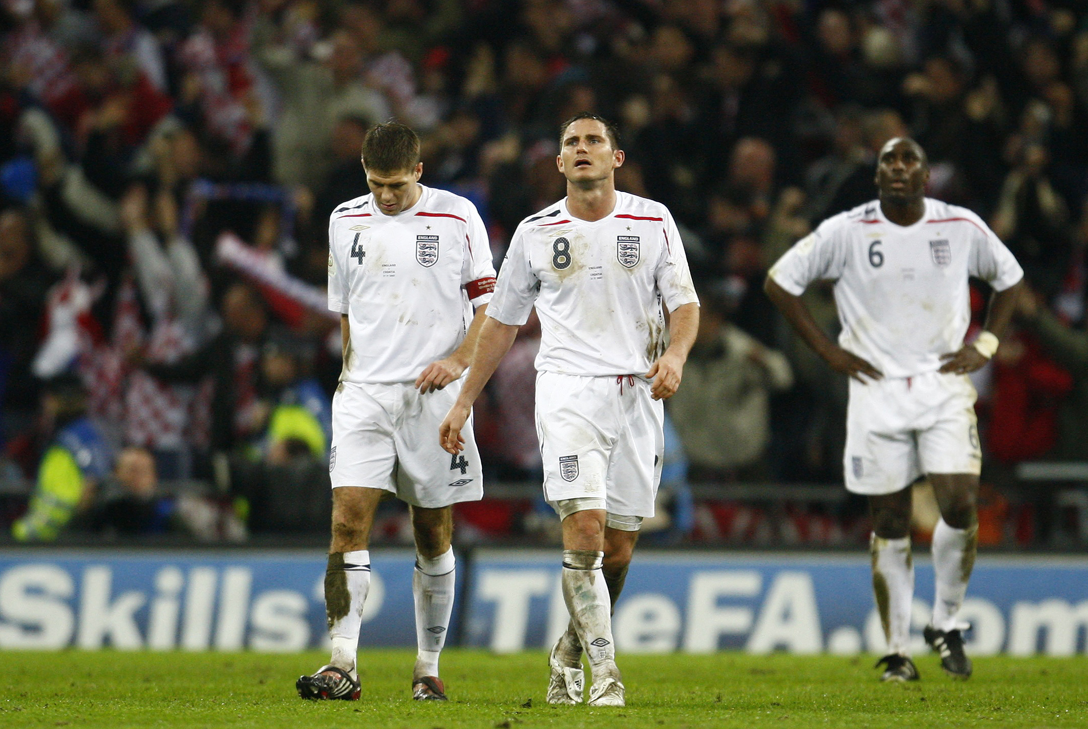 Former England players Steven Gerrard (left), Frank Lampard and Sol Campbell (behind) react after losing to Croatia in 2007 | Picture courtesy: Reuters