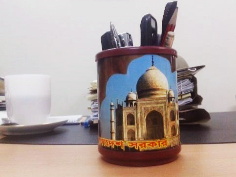 "A mug bearing the words ""Bangladesh Shorkar"", photographed at the Ministry of Finance, in Dhaka. Photo credit: Hugo Ribadeau Dumas"