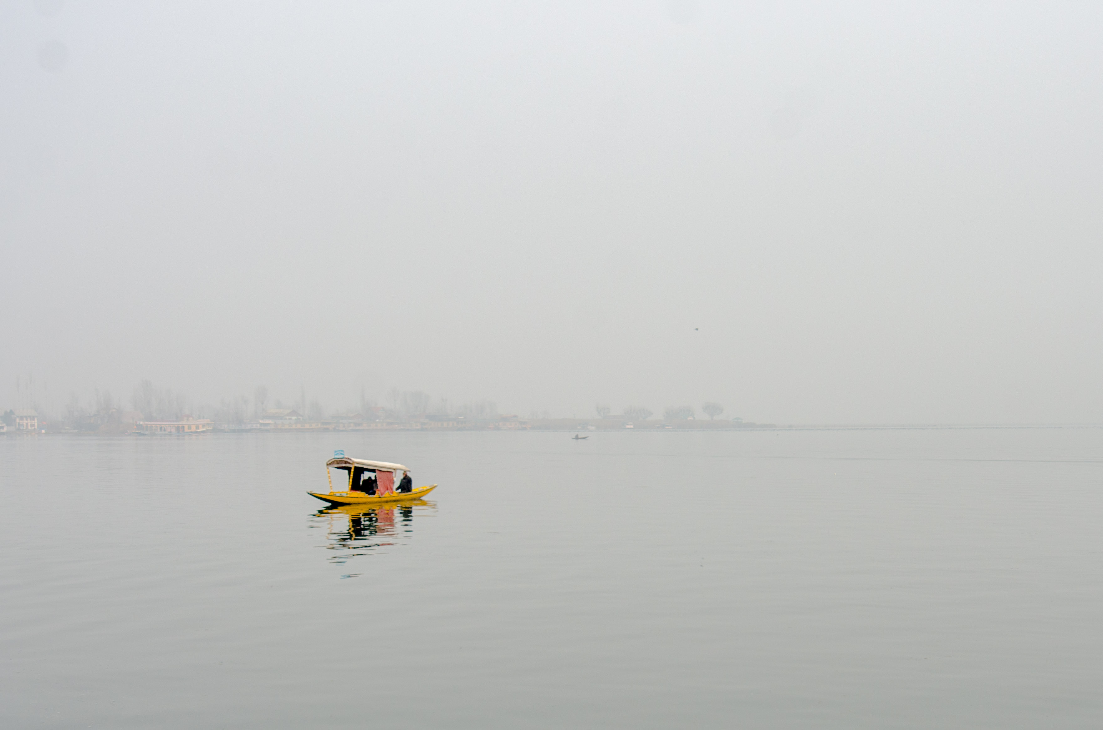 A solitary shikara on a chilly afternoon on the Dal Lake in Srinagar. Photo: Rayan Naqash