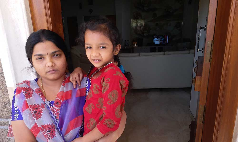 Kalpana Gowda and her daughter at their home in Bengaluru. Political rivals killed her husband Chikka Thimme Gowda. Photo: Sruthisagar Yamunan