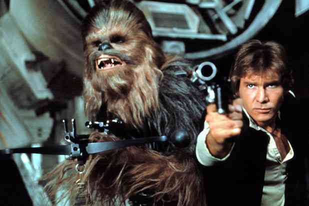 Peter Mayhew as Chewbacca (left) and Harrison Ford as Han Solo in Star Wars (1977). Courtesy Lucasfilm.