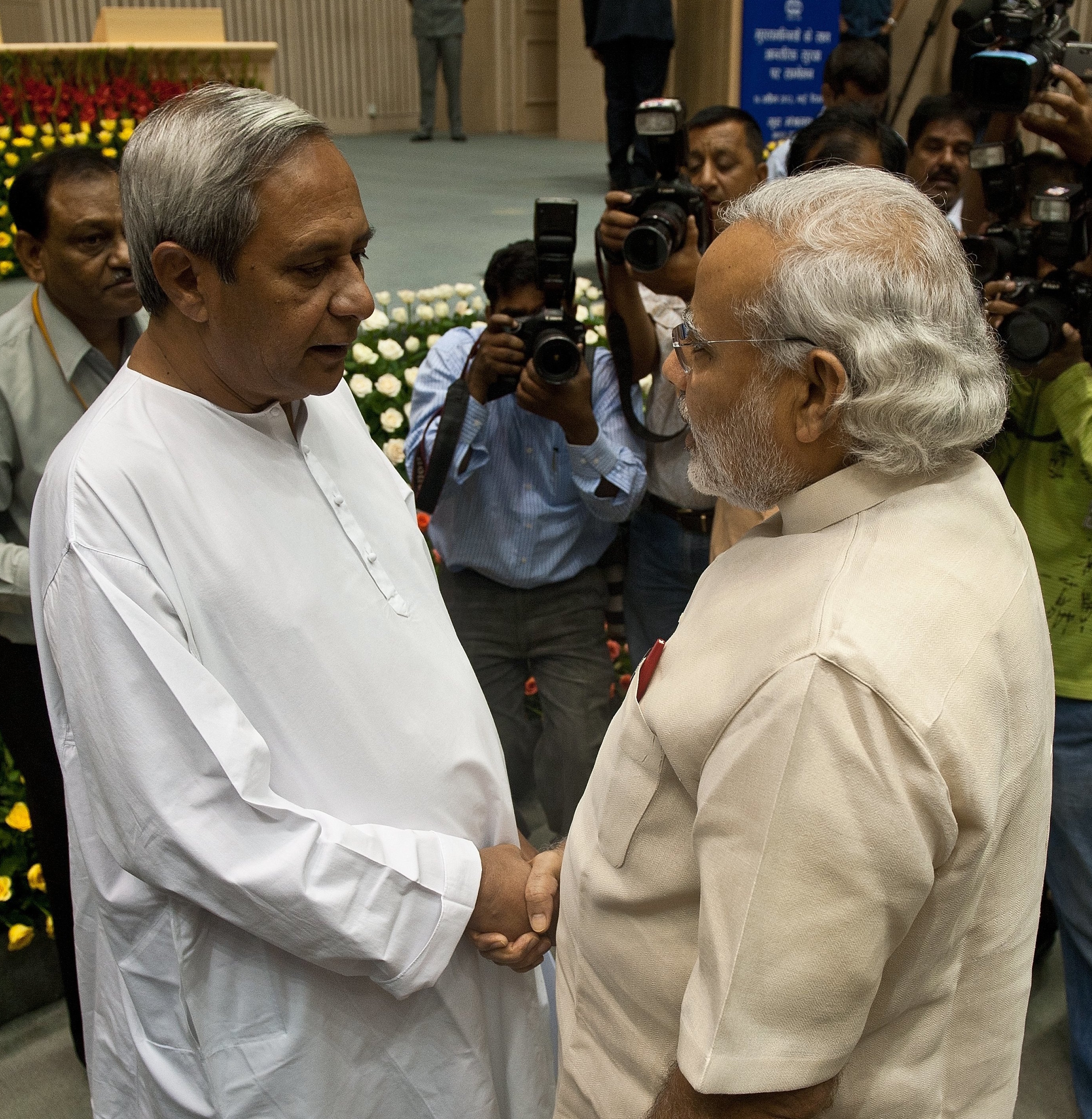 The BJP-led government announced the election as soon as it was assured of the support of the Biju Janata Dal, led by Naveen Patnaik (left), and the Telangana Rashtriya Samithi. (Credit: AFP)