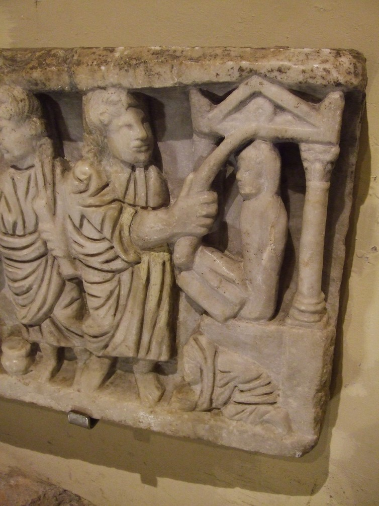A carved sarcophagus (4th century CE) depicts Jesus raising Lazarus (far right). Photo by Dr Meredith J C Warren.