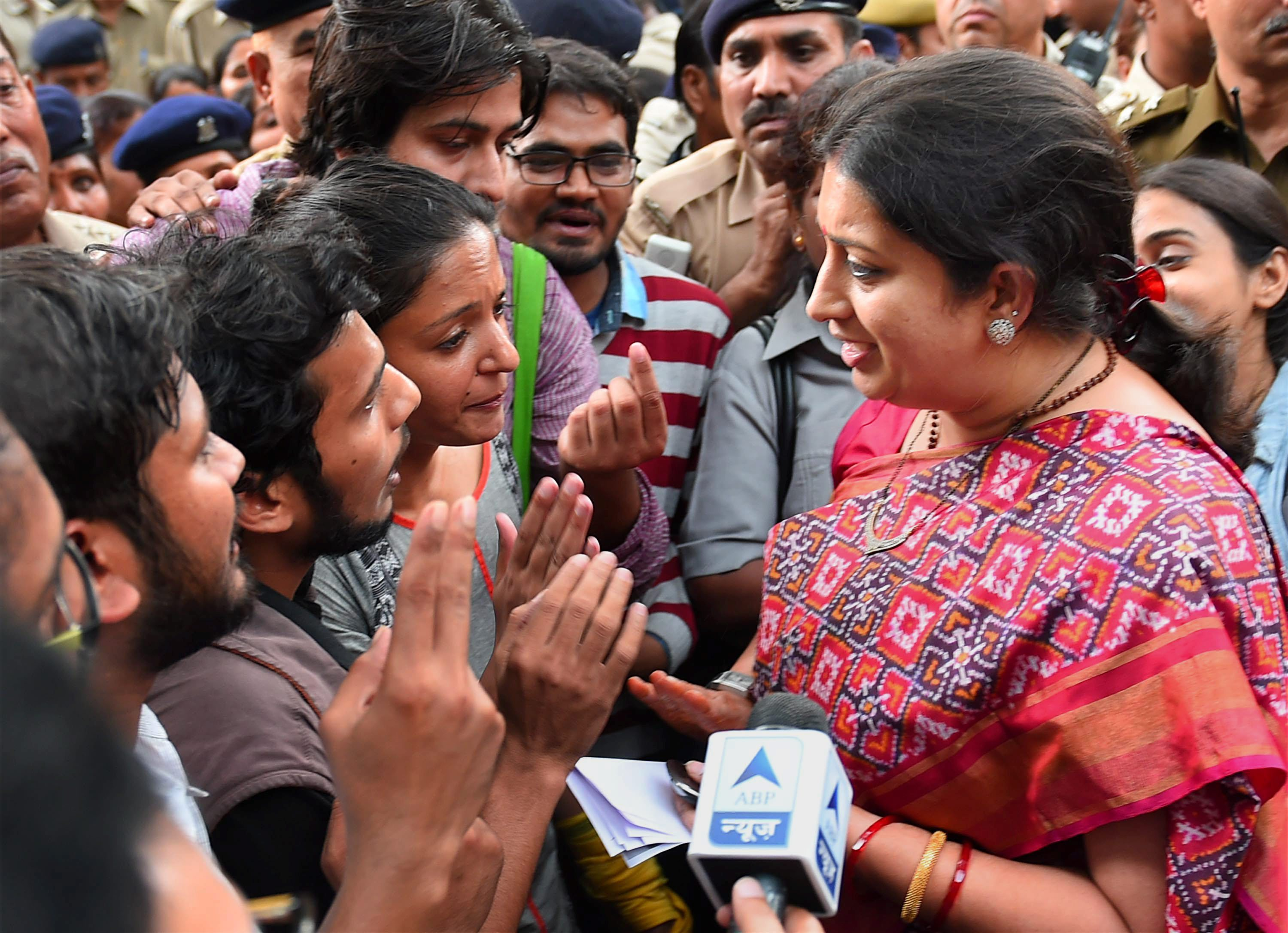 Former education minister Smriti Irani with students protesting the scrapping of PhD fellowships in November 2015. (Photo credit: PTI File)