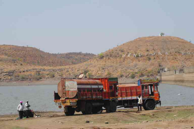 Tankers fill water at Bendsura dam in Beed district. (Photo credit: Meena Menon).