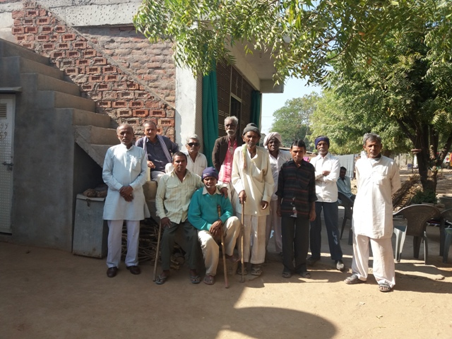 Pravinbhai Parmar (third from left) with other Dangasiya men outside their rehabilitation homes in Surendranagar. (Photo credit: Aarefa Johari).