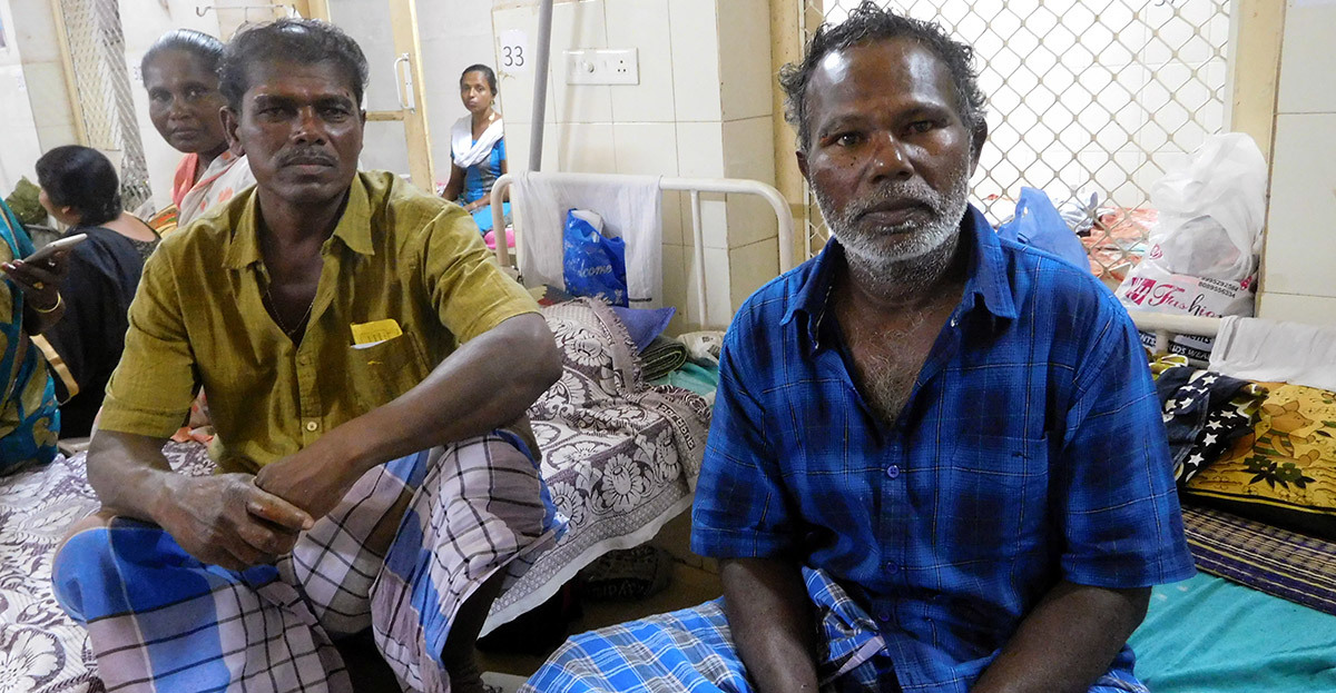 Devadas (left) and Joseph were rescued by aircraft on Saturday after their boats capsized on the deep seas on Friday. They are undergoing treatment at the Government General Hospital in Thiruvananthapuram. Credit: TA Ameerudheen