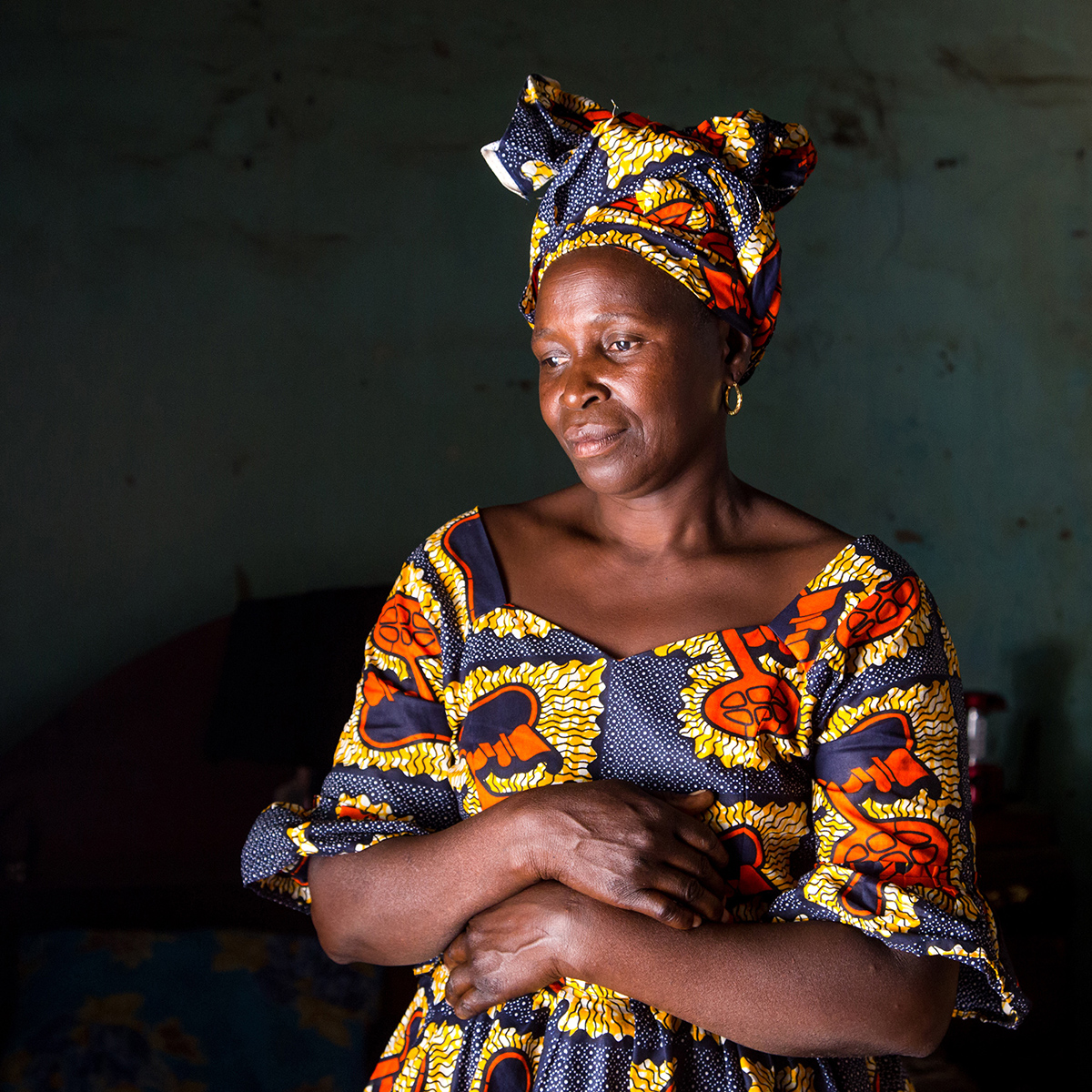 Photograph by Asha Miles, from the series 'Scars', the stories of 12 Gambian women who survived female genital mutilation as children. Pictured here is, Fatou Bojang, 52. © Asha Miles, Russian Federation, Shortlist, Professional, Current Affairs & News (Professional competition), 2018 Sony World Photography Awards.