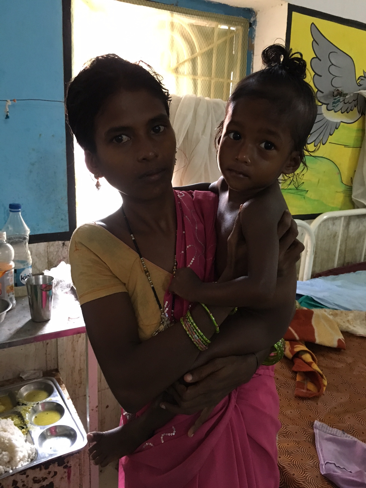 A tribal woman holding her malnourished child at the Nutrition Rehabilitation Centre in Malkangiri. Photo: Priyanka Vora