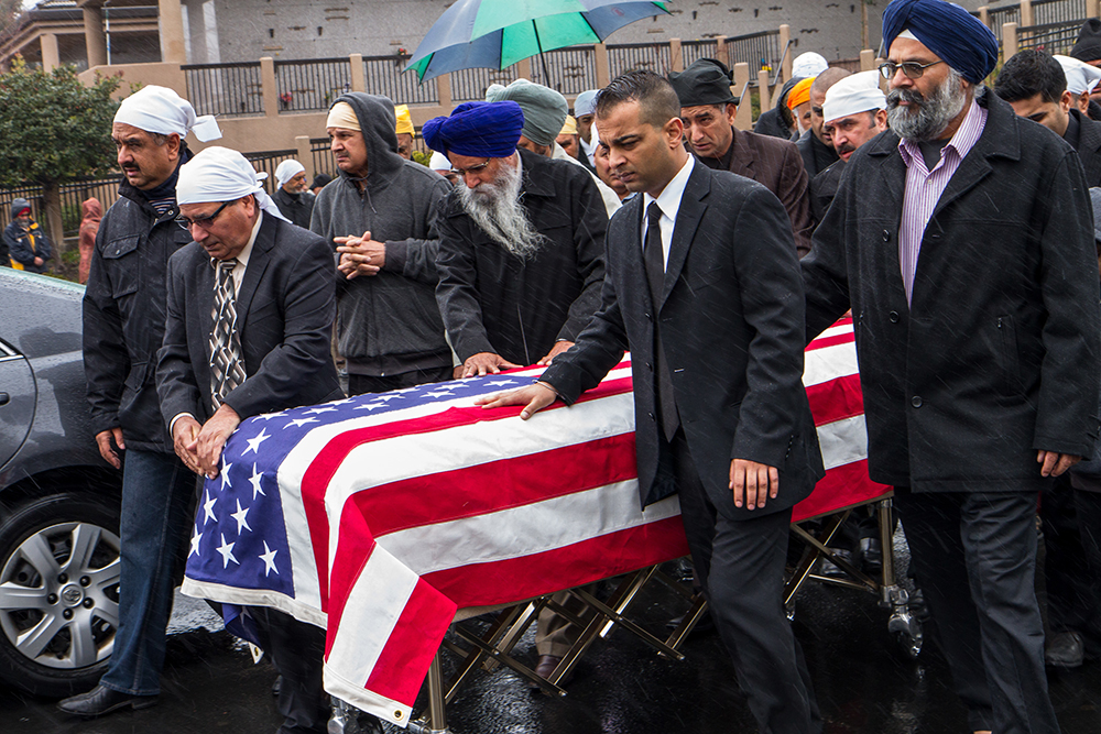 Lodi, California: Mourners attend the flag-draped coffin of Parminder Singh Shergill, a US Army veteran of the first Gulf War who was shot by the police near his home. Officers claim Shergill, 43, who struggled with mental illness, lunged at them with a knife; witnesses disputed the police account. He was buried with military honours.