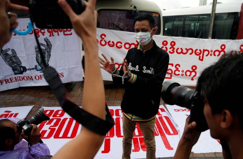 A Burmese reporter protests against the detention of reporters in Myanmar, on June 30. Photo credit: Soe Zeya Tun/Reuters