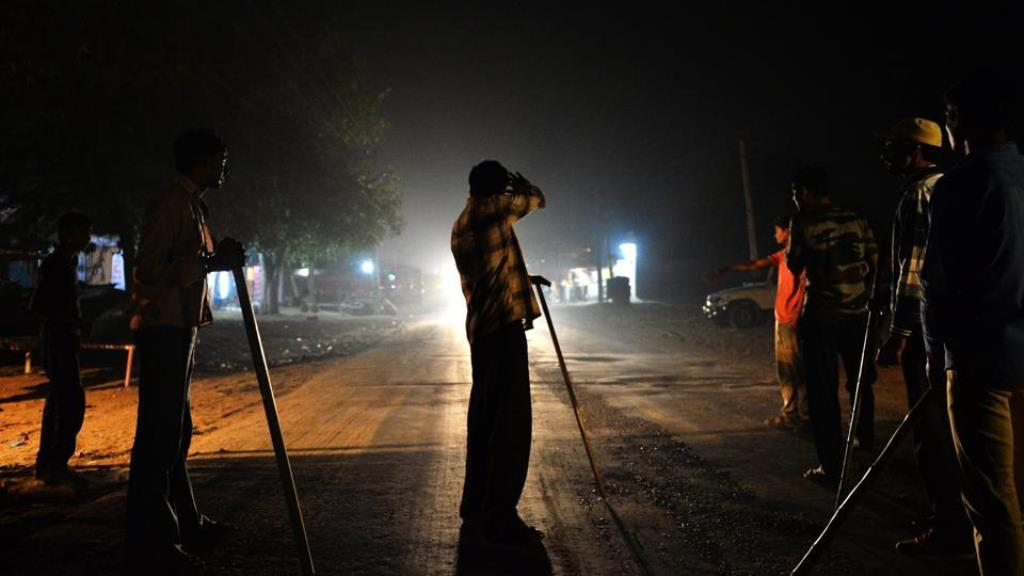 Gau Raksha Dal members out to inspect trucks on a highway in Taranagar, Rajasthan. Image credit: AFP