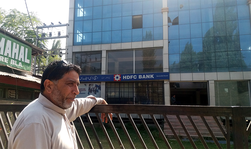 Farooq  Ahmed Shaal stands in front of the mall that has replaced Regina Cinema. Photo credit: Ipsita Chakravarty
