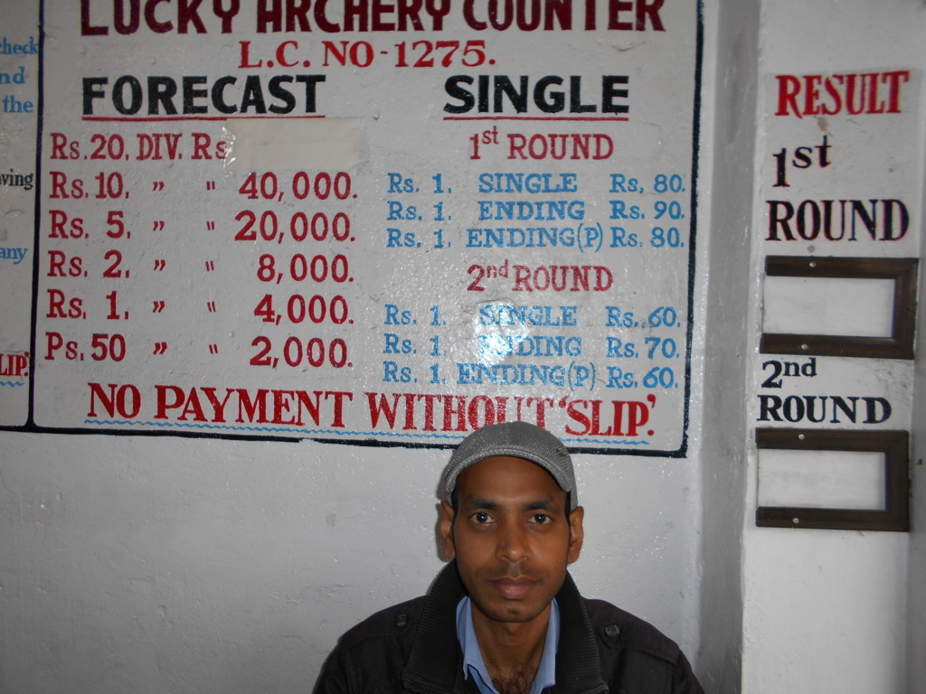 Raju Prasad sitting at the Lucky Archery counter