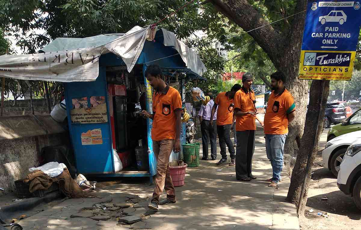 "Delivery executives working for Swiggy gather at a tea shop in Chennai for a break before they begin work at the ""lunch peak"" hour."