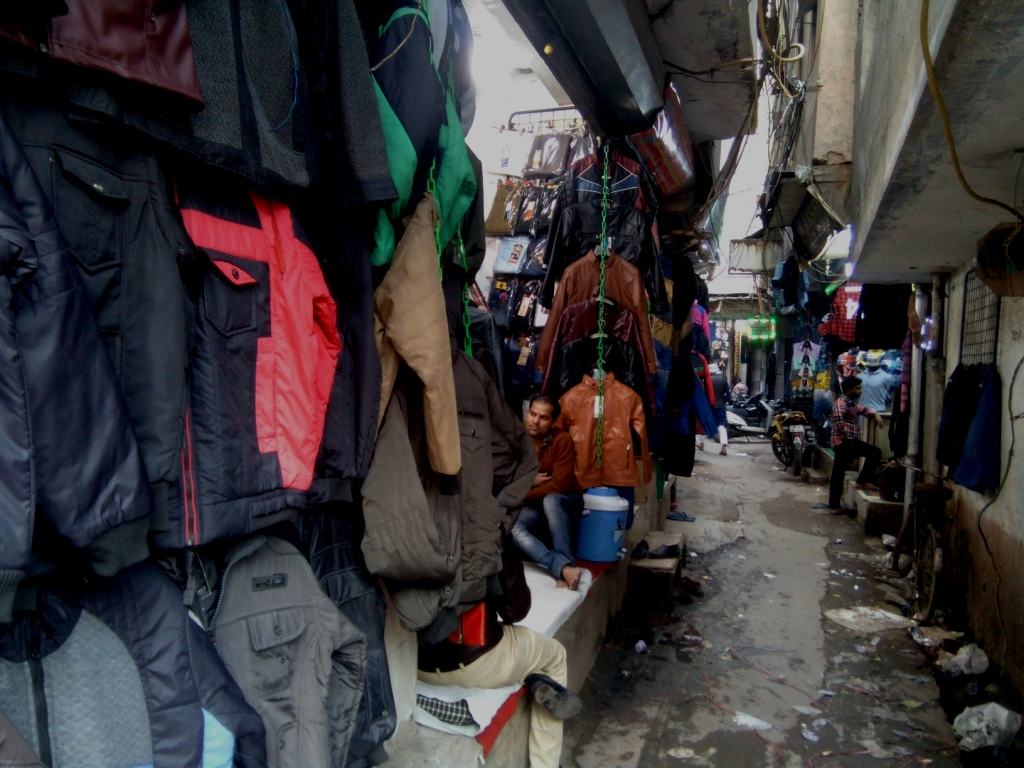 A lane leading to the wholesale garments market in Gandhi Nagar Market. Image Credit: Abhishek Dey