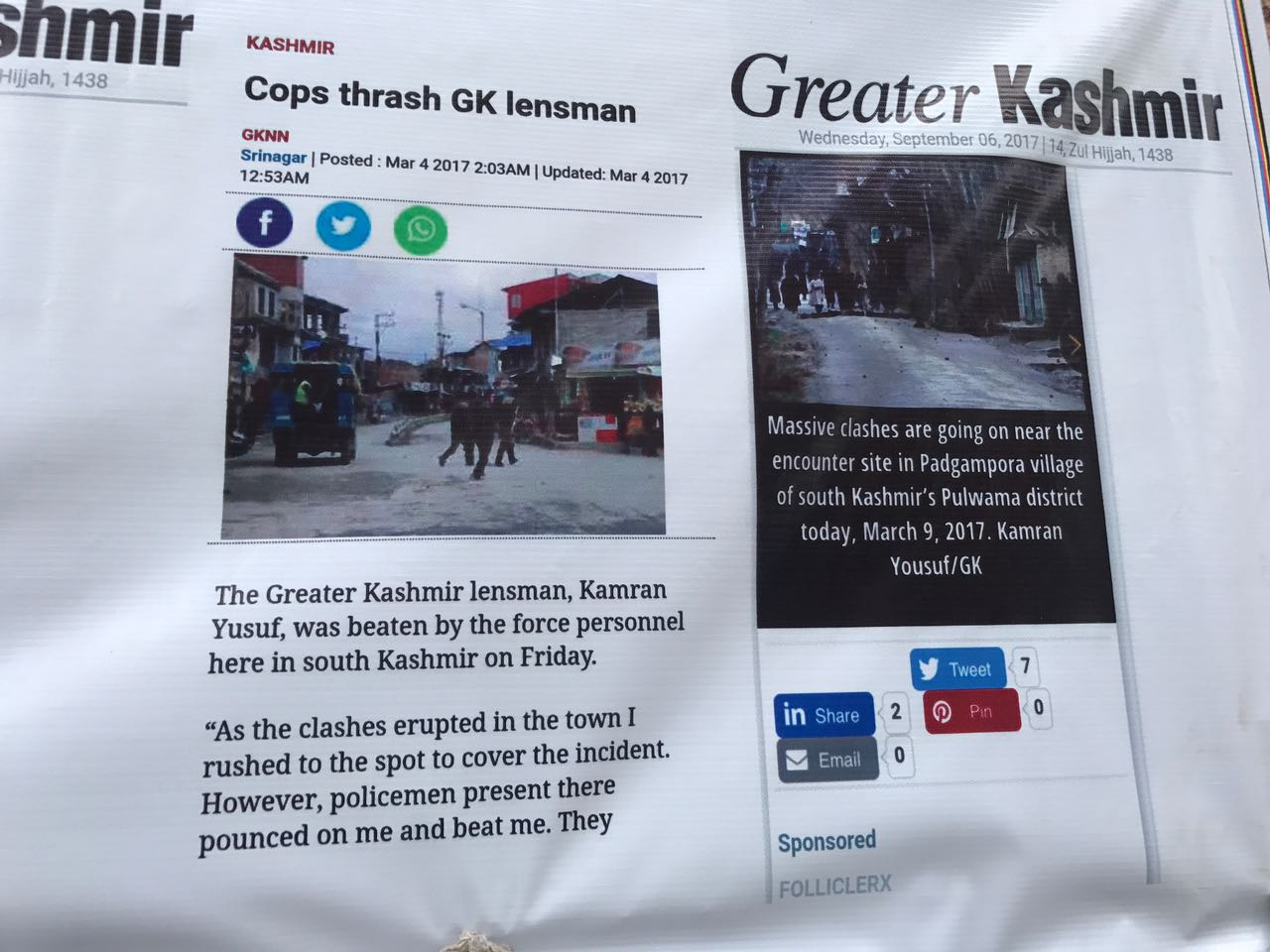A screenshot of the report, printed onto a banner by protesting south Kashmir journalists.