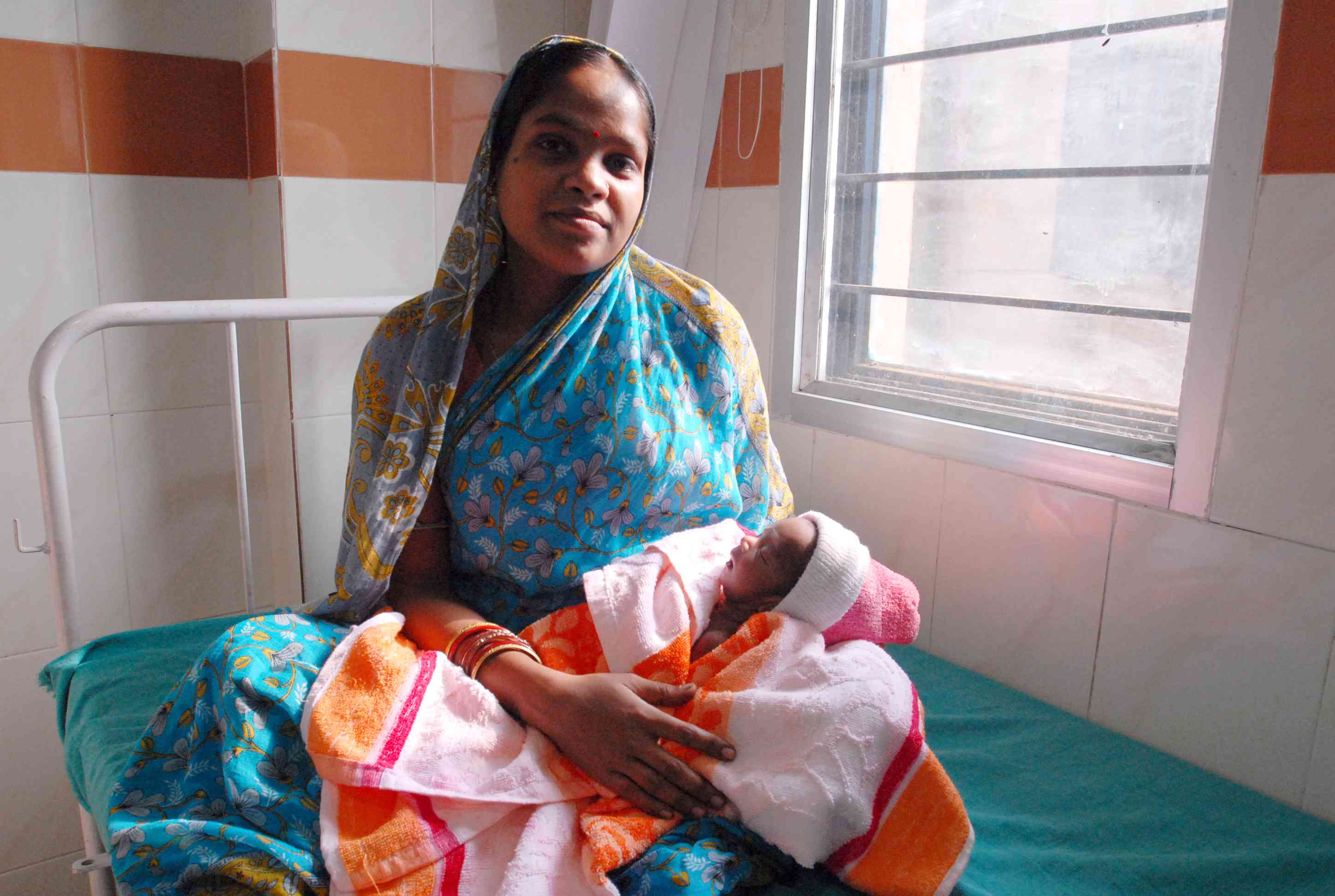 A mother and her newborn child, beneficiaries of a UK-funded maternal health and family planning programme in Orissa, one India's poorest states. Photo Credit: Pippa Ranger/Department for International Development [Licensed under CC BY 2.0]